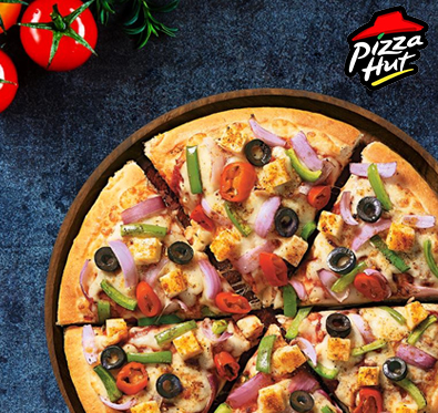 Enjoy buy one get one offer on pizza & garlic bread @ Pizza Hut